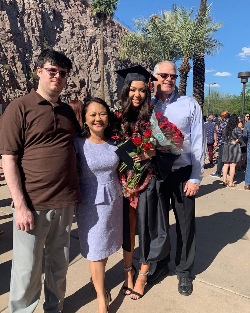 Kailey Amora Posing with Father Mother and Brother after Graduation