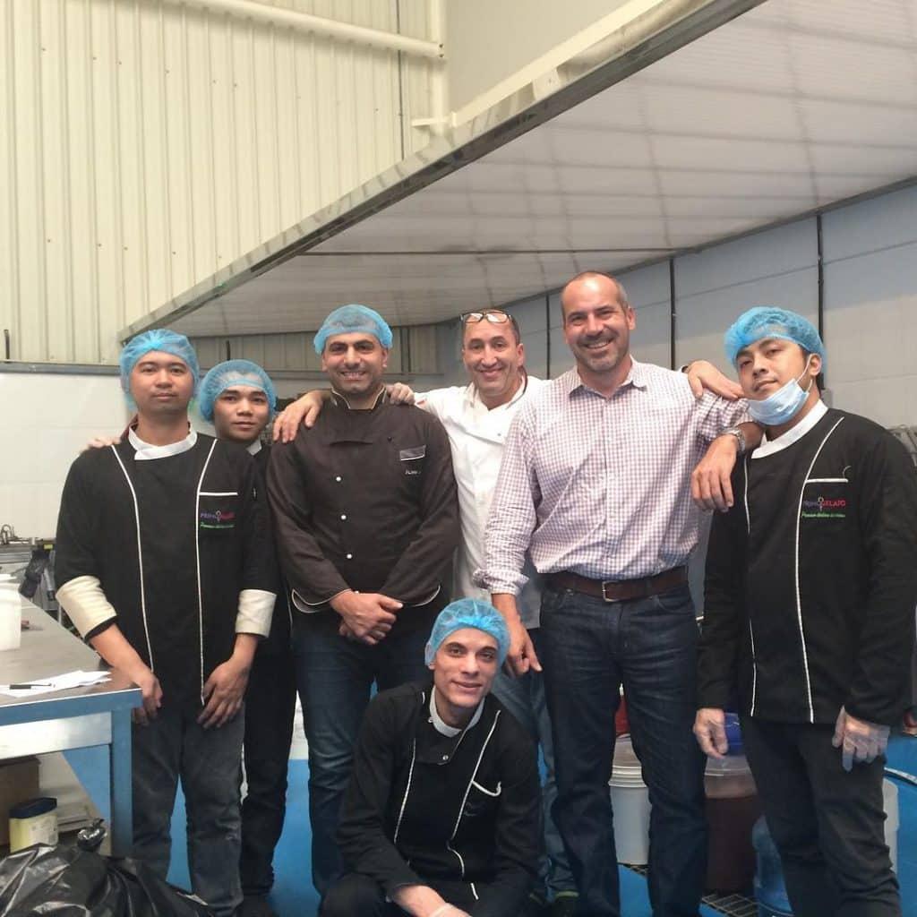 Yanal Beasha in Ice Cream Factory with Employees